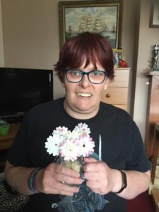 Picture of Kirsty holding some flowers