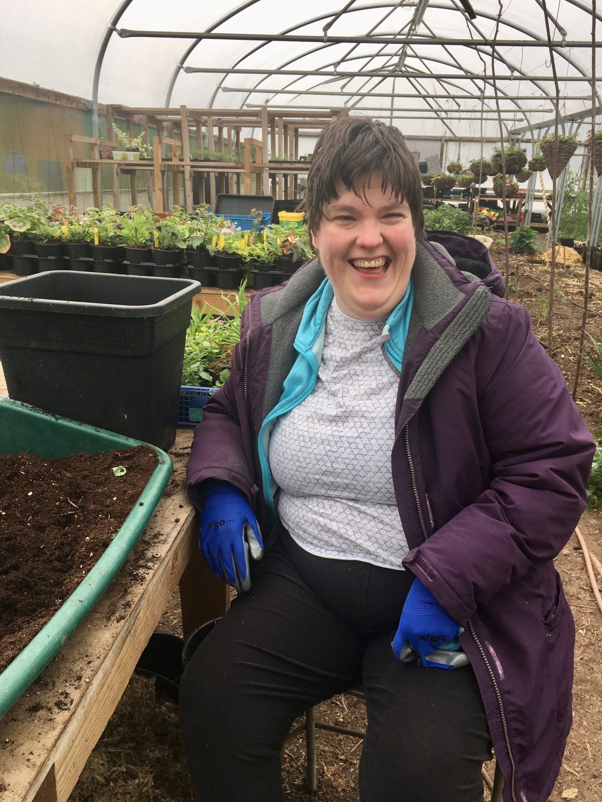Chelsea enjoying herself at Flower Pod in the polytunnel